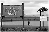 Fishing Hole signs. Homer, Alaska, USA ( black and white)