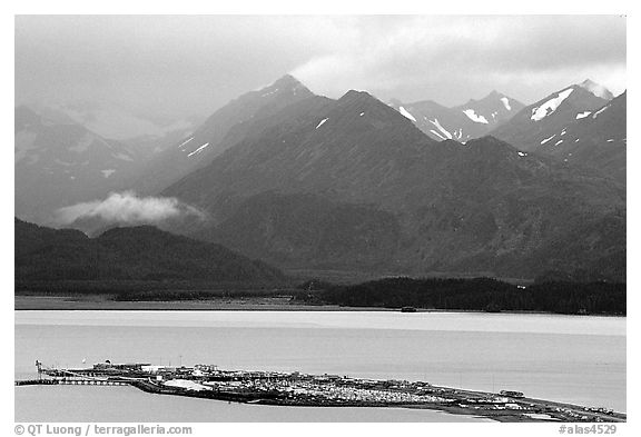 Distant view of the Spit and Kenai Mountains. Homer, Alaska, USA (black and white)