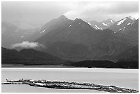 Distant view of the Spit and Kenai Mountains. Homer, Alaska, USA ( black and white)