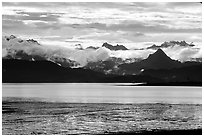 Low clouds haning over Kenai Mountains across Katchemak Bay. Homer, Alaska, USA ( black and white)