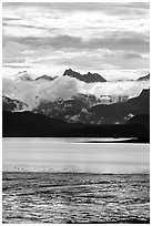 Low clouds hanging over Kenai Mountains across Katchemak Bay. Homer, Alaska, USA ( black and white)