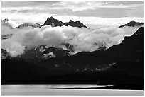 Mountains rising above bay with low clouds. Homer, Alaska, USA (black and white)