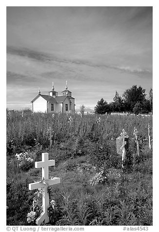 Russian orthodox cemetery and old Russian church. Ninilchik, Alaska, USA (black and white)