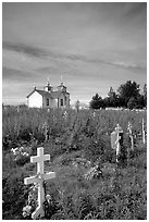 Russian orthodox cemetery and old Russian church. Ninilchik, Alaska, USA ( black and white)