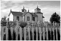 Picket Fence and old Russian church. Ninilchik, Alaska, USA (black and white)
