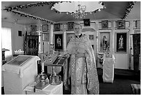 Orthodox priest inside the old Russian church. Ninilchik, Alaska, USA (black and white)