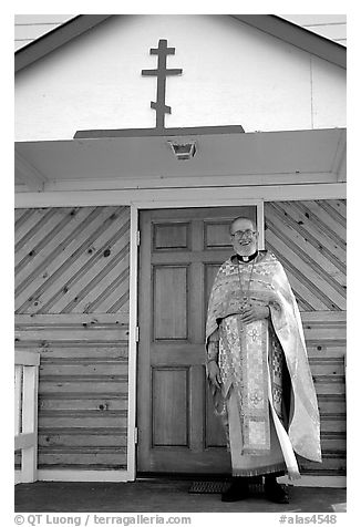 Orthodox priest ouside the old Russian church. Ninilchik, Alaska, USA (black and white)