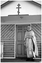 Orthodox priest ouside the old Russian church. Ninilchik, Alaska, USA ( black and white)