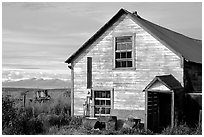 Old wooden house in  village. Ninilchik, Alaska, USA ( black and white)