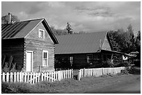 White picket fence and wooden houses. Hope,  Alaska, USA (black and white)