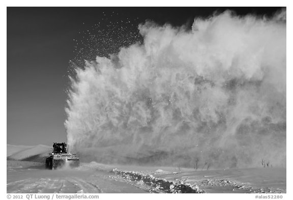 Snow plow truck with cloud of snow. Alaska, USA (black and white)