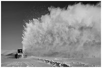 Snow plow truck with cloud of snow. Alaska, USA ( black and white)