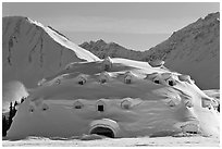 Snow-covered dome-shaped building. Alaska, USA ( black and white)