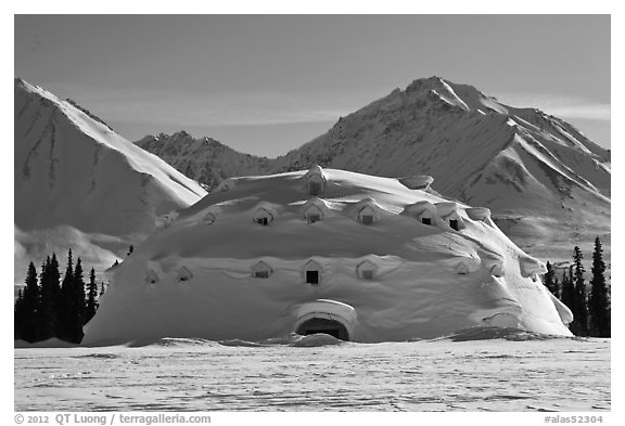 Snowy dome-shaped building and mountains. Alaska, USA (black and white)