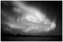 Magnetic storm in sky above snowy meadow. Alaska, USA ( black and white)