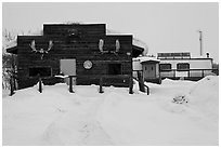 Log cabin and Slate Creek Motel, Coldfoot. Alaska, USA ( black and white)