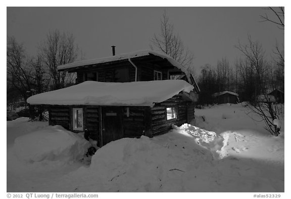 Log cabin at night. Wiseman, Alaska, USA (black and white)