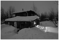 Log cabin at night. Wiseman, Alaska, USA ( black and white)
