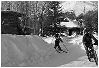 Winter recreation with snow-tired bike and skis. Wiseman, Alaska, USA ( black and white)
