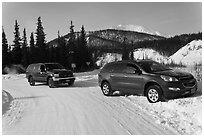 Car being pulled out of snowbank. Wiseman, Alaska, USA (black and white)