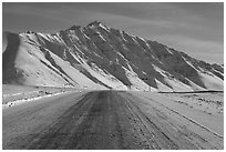 Frozen James Dalton Highway below Arctic Mountains. Alaska, USA (black and white)