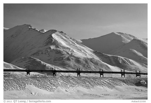 Trans Alaska Pipeline and snow-covered mountains. Alaska, USA (black and white)