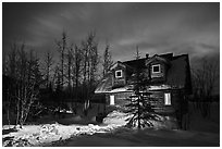 Cabin at night with Aurora Borealis. Wiseman, Alaska, USA ( black and white)