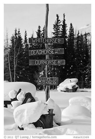 Signs in winter. Wiseman, Alaska, USA (black and white)