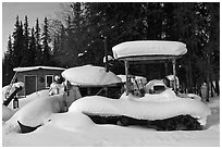 Machinery covered in snow. Wiseman, Alaska, USA (black and white)