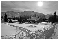 Backlit view of snow-covered village. Wiseman, Alaska, USA ( black and white)
