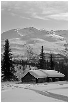 Snowy cabin and mountains. Wiseman, Alaska, USA ( black and white)