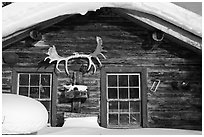 Log cabin facade with antlers. Wiseman, Alaska, USA ( black and white)