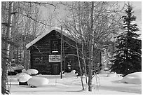 Storebuilding in winter. Wiseman, Alaska, USA ( black and white)