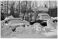 Trucks covered with piles of snow. Wiseman, Alaska, USA (black and white)