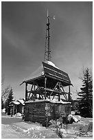 Tower with solar panels and windmill. Wiseman, Alaska, USA ( black and white)