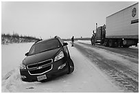 Car stuck in snow along Dalton Highway. Alaska, USA (black and white)