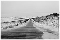 Windblown drifted snow across Dalton Highway. Alaska, USA ( black and white)