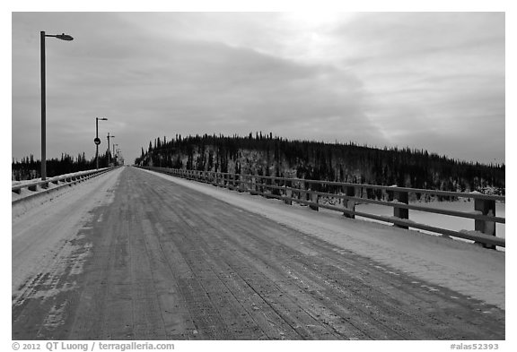 Long wooden bridge across Yukon River. Alaska, USA (black and white)