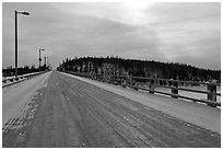 Long wooden bridge across Yukon River. Alaska, USA ( black and white)