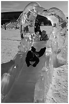 Children slide through ice sculpture. Fairbanks, Alaska, USA ( black and white)