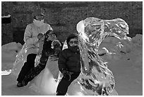 Family riding camel carved out of ice. Fairbanks, Alaska, USA ( black and white)