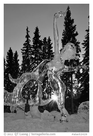 Sun setting over ice sculpture, World Ice Art Championships. Fairbanks, Alaska, USA (black and white)