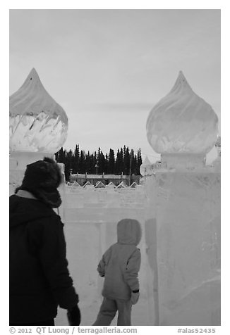 Family enters ice maze, George Horner Ice Park. Fairbanks, Alaska, USA (black and white)