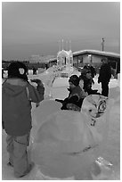 Children playing on ice sculptures, Ice Alaska. Fairbanks, Alaska, USA (black and white)
