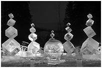 Balancing cubes made of ice at night, World Ice Art Championships. Fairbanks, Alaska, USA ( black and white)