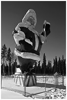 Santa Claus statue surrounded by barbed wire. North Pole, Alaska, USA ( black and white)