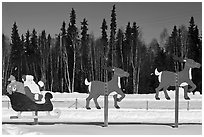 Santa Claus and reinder cut-out in winter. North Pole, Alaska, USA (black and white)