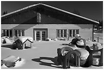 Playground in winter in front of day care. North Pole, Alaska, USA ( black and white)