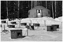 Doghouses and yurt tent. North Pole, Alaska, USA (black and white)