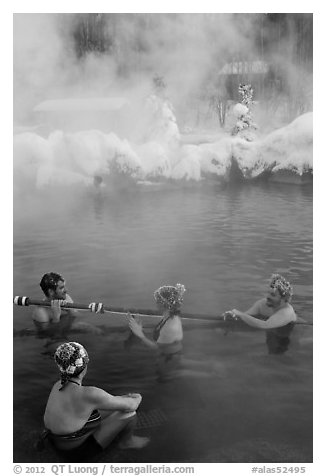 People with frozen hair relaxing in hot springs. Chena Hot Springs, Alaska, USA (black and white)